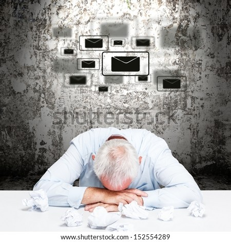 Tired and exhausted businessman dreaming letters - stock photo