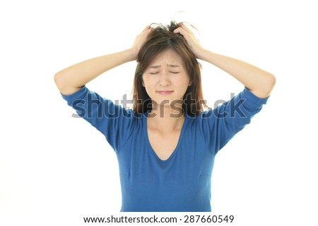 Tired and stressed Asian woman