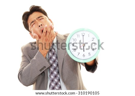 Tired Asian businessman