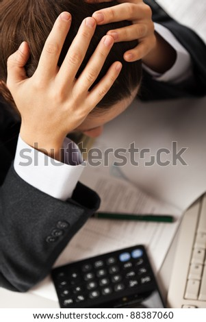 Tired business man hand holding head in stress or problems at office workplace desk - stock photo