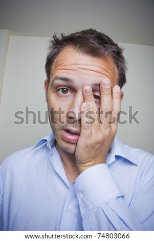 Tired business man rubbing his eyes. - stock photo
