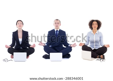 tired business people sitting in yoga pose with laptops isolated on white background