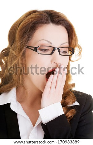 Tired business woman in a suit ,isolated over white background - stock photo