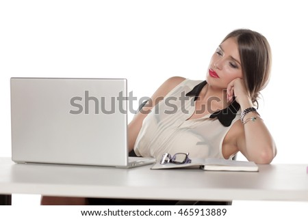 Tired business woman sitting at her desk with a laptop