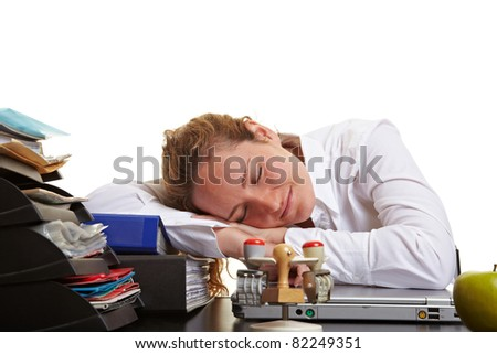 Tired business woman sleeping on her desk in the office - stock photo