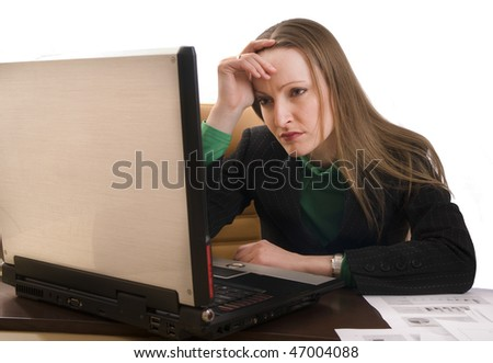 Tired business woman with her computer thinks about the problem