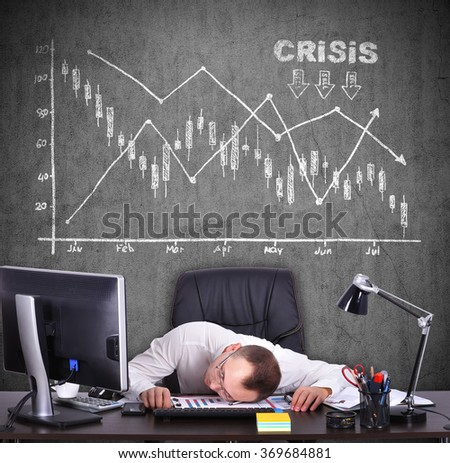 Tired businessman and drawing crisis chart over head - stock photo