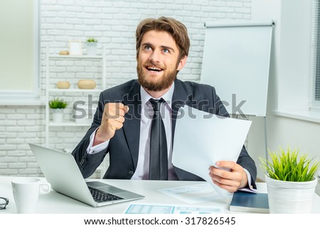 Tired businessman at work in office