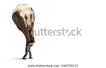 Tired businessman carrying elephant on his back - stock photo