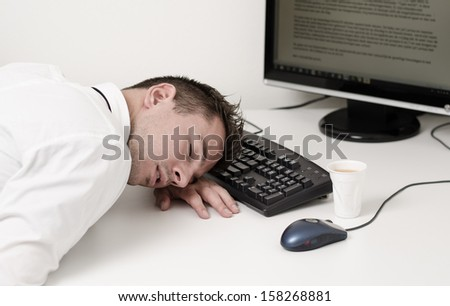 tired businessman sleeping on computer - stock photo