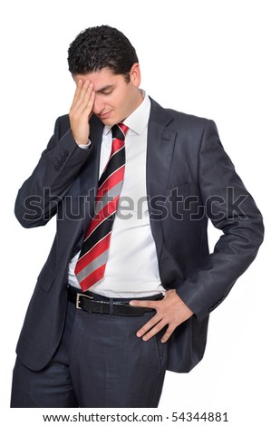 Tired businessman touches his head.
