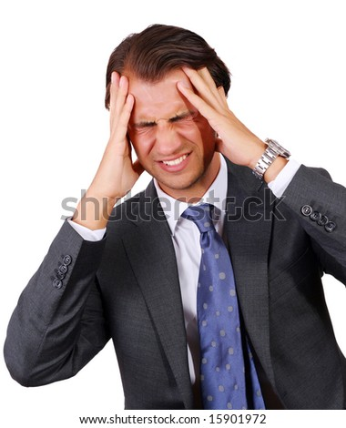 Tired Businessman with lots of problems having a headache and holding his forehead - stock photo