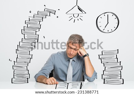 Tired Businessman Working and Studying Till Late In Office - stock photo