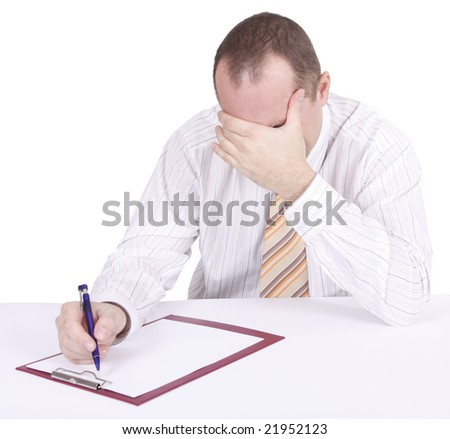 tired businessman writing on clipboard