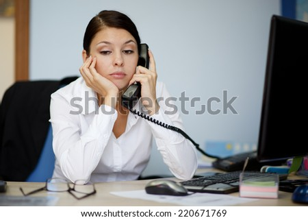Tired businesswoman - stock photo