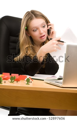 Tired businesswoman with telephone and a sheet of paper in her hands sitting - stock photo