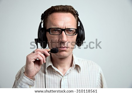 Tired call center operator - stock photo