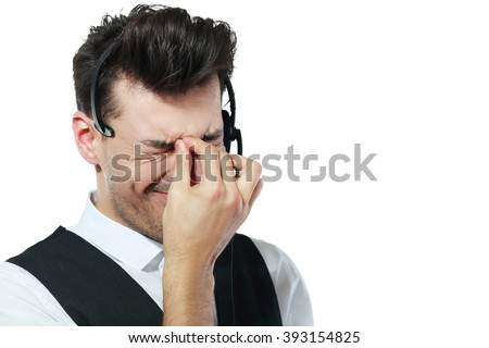 Tired call center operator isolated over white have a headache - stock photo