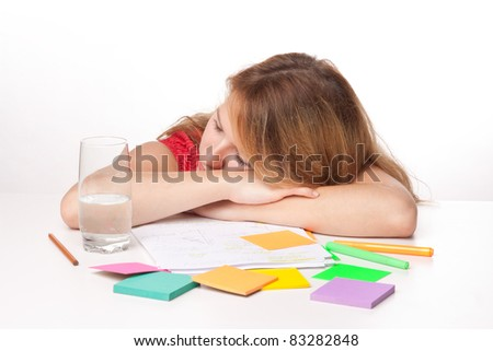 Tired college student is having a rest during studying (swot up) for exam