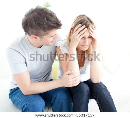 Tired couple having an argue together in the living-room - stock photo