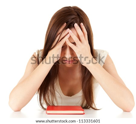 tired, depressed  female student with book, white background - stock photo