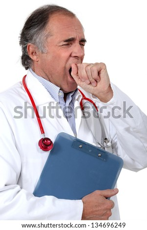 Tired doctor yawning - stock photo