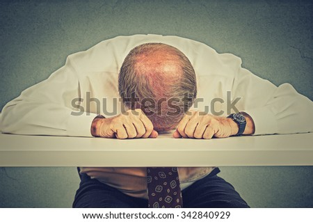 Tired elderly business man sleeping in his office