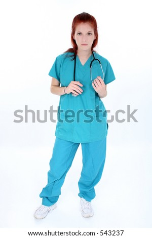 Tired emergency room nurse standing over white.  Young woman in teal scrubs with stethoscope.  Shot in studio. - stock photo