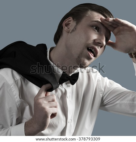 Tired, exhausted young businessman. Isolated on a gray background. - stock photo