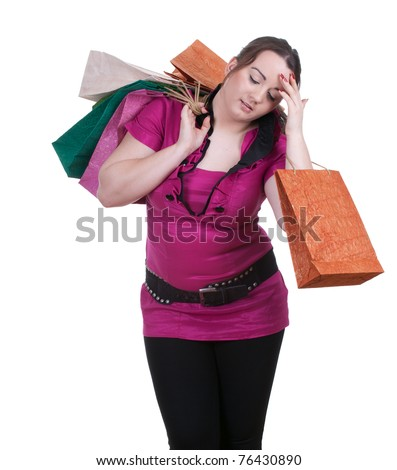 tired fat young woman with shopping bags - stock photo
