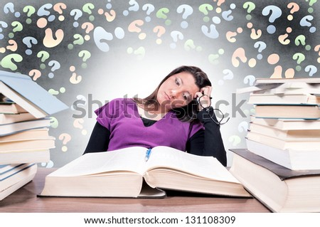 Tired female student have a problems with learning. Selective focus on the female - stock photo