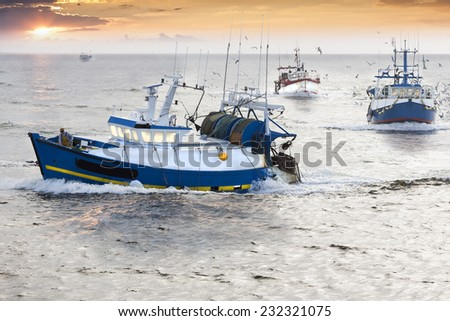 Tired fisherman homewards at the end of a hard day in France - stock photo