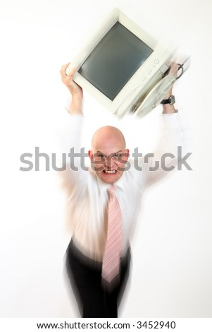 Tired, freaked-out business man throwing computer monitor. - stock photo