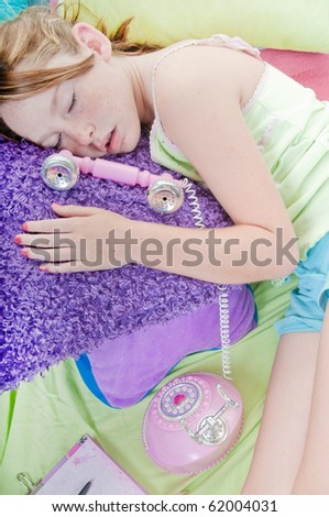 Tired girl falls asleep during phonecall - stock photo
