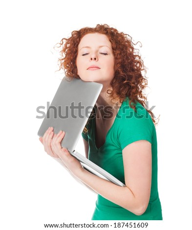 Tired girl holding a laptop.  Isolated on white background - stock photo