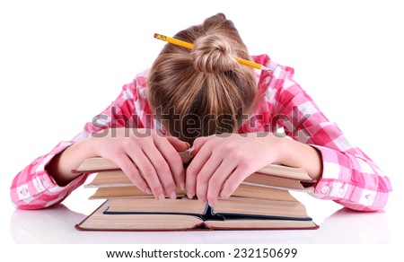 Tired girl with books isolated on white - stock photo