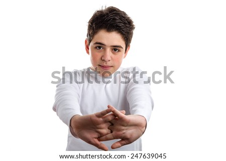 Tired Hispanic boy with acne skin in a white long sleeve t-shirt stretching his back with clasped hands - stock photo
