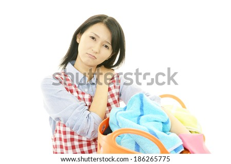 Tired housewife - stock photo
