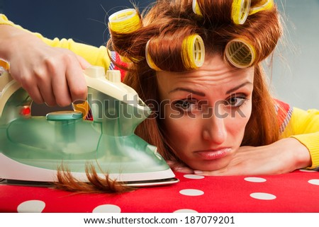 Tired housewife with  ironing-board - stock photo