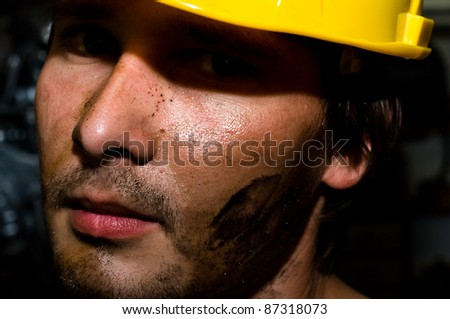 Tired industrial worker - stock photo