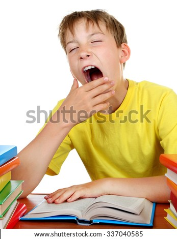 Tired Kid Yawn at the School Desk with a Books on the White Background - stock photo