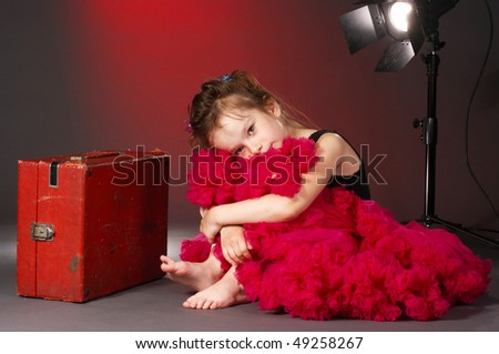 tired little actress on the stage - stock photo