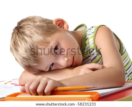 Tired little schoolboy - stock photo
