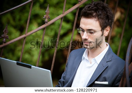 Tired Man Businessman overworking outdoors,Italy - stock photo