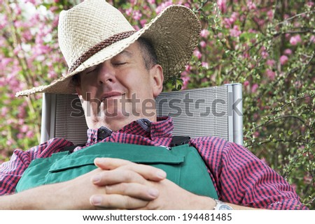 Tired man resting under the tree: - stock photo