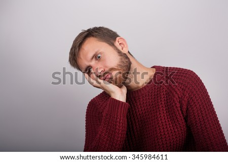 Tired man sleeping on chair resting on his arm - stock photo