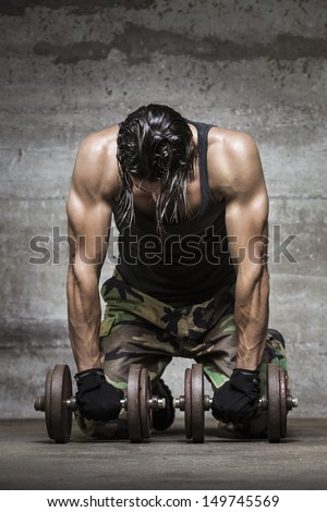 tired muscle athlete - stock photo