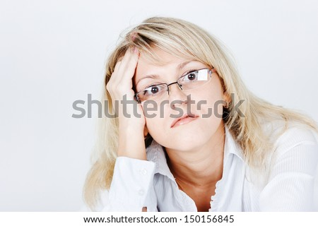 Tired of attractive young blond woman in glasses. portrait - stock photo