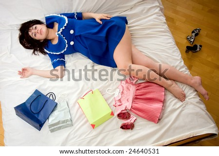 tired pregnant woman after shopping - stock photo