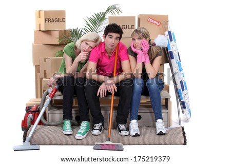 Tired roommates on moving day - stock photo
